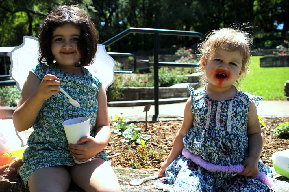 Sophia, age 4 (pictured left), and Stella, age 1 (pictured right), treating themselves to a delicious slushie.