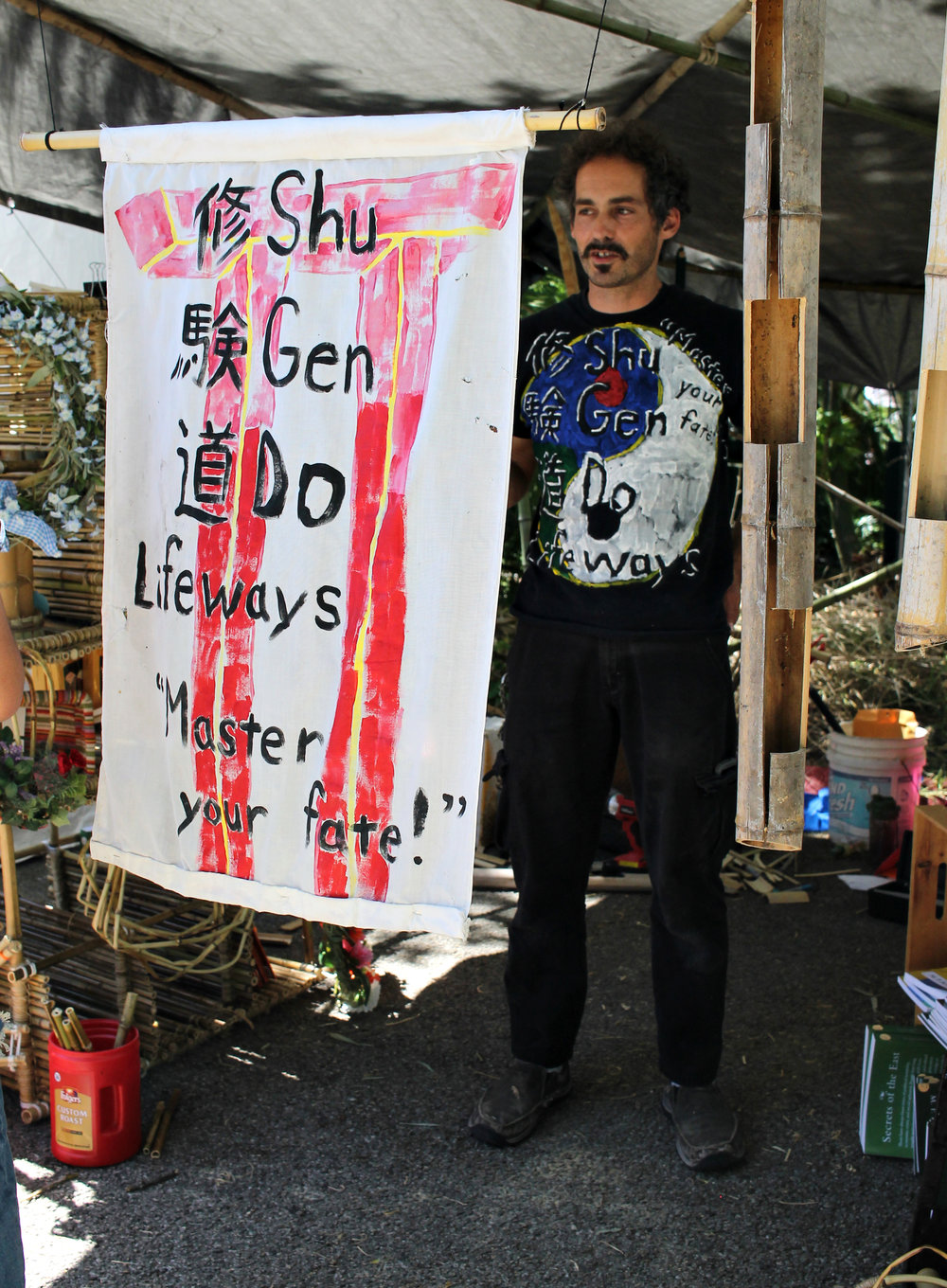 Vendor Michael Schaefer with his shop Shu Gen Do where he sells an arrangement of bamboo pieces.