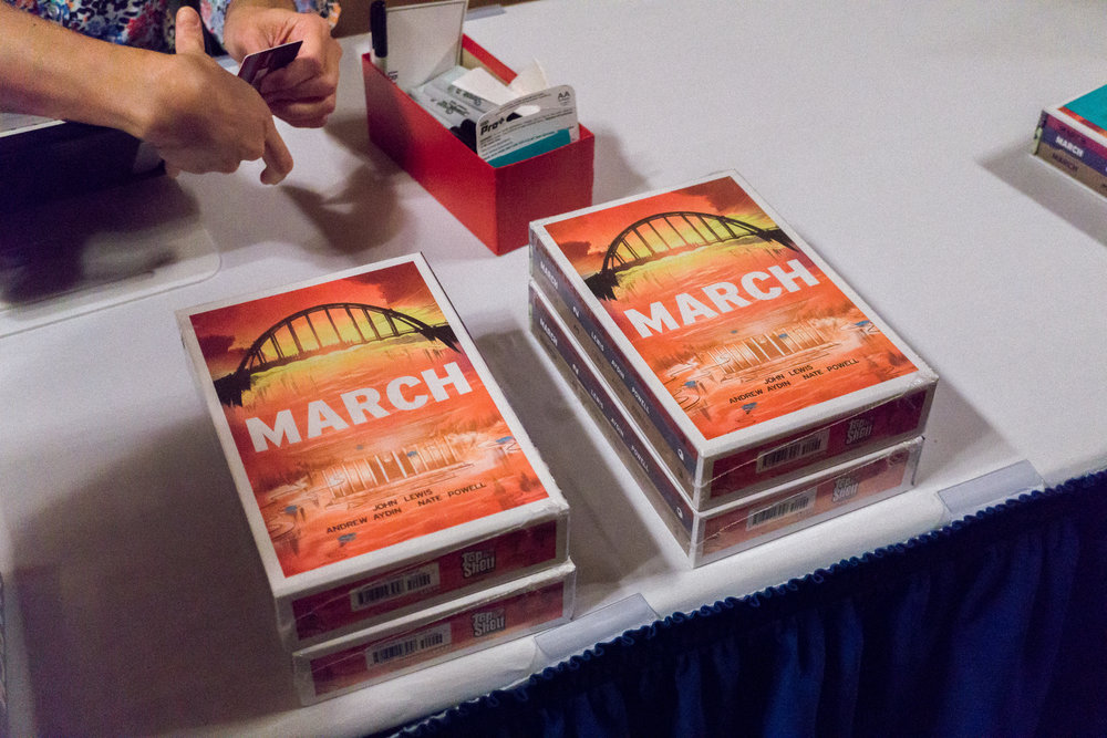 A copy of MARCH ON, a three part graphic novel that tells the story of Civil Rights activists and their commitments to justice and equality.