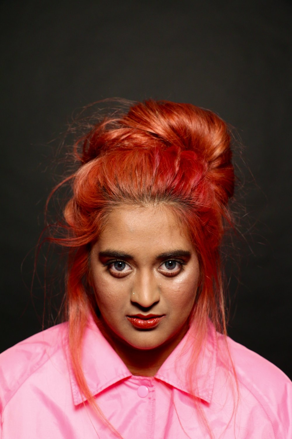 Shorna Haque stands out with her hot pink hair.