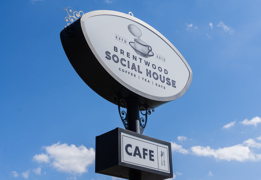The Brentwood Social House sign stands outside the restaurant.