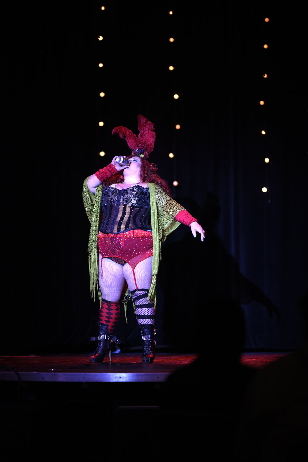 "Sanders performs as Ginger Snaps in Black Widow Burlesque's ""Best in Show"" to a performance called ""Wasted."""