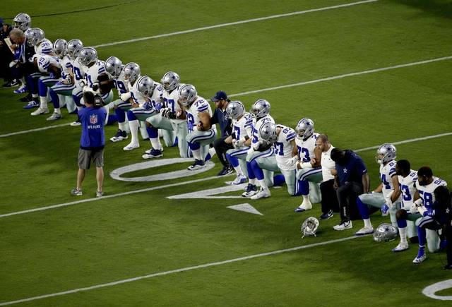 Dallas Cowboys kneeling prior to the playing of the National Anthem before they played the Arizona Cardinals on September 26, 2017. Photo courtesy of the Austin American-Statesman.