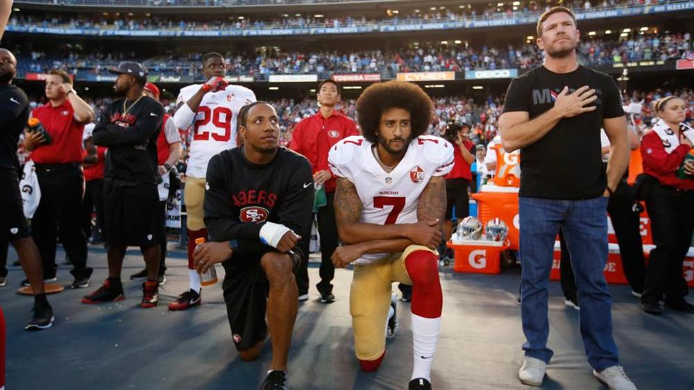Colin Kaepernick taking a knee before a 2016 NFL preseason game. Photo courtesy of NBC.