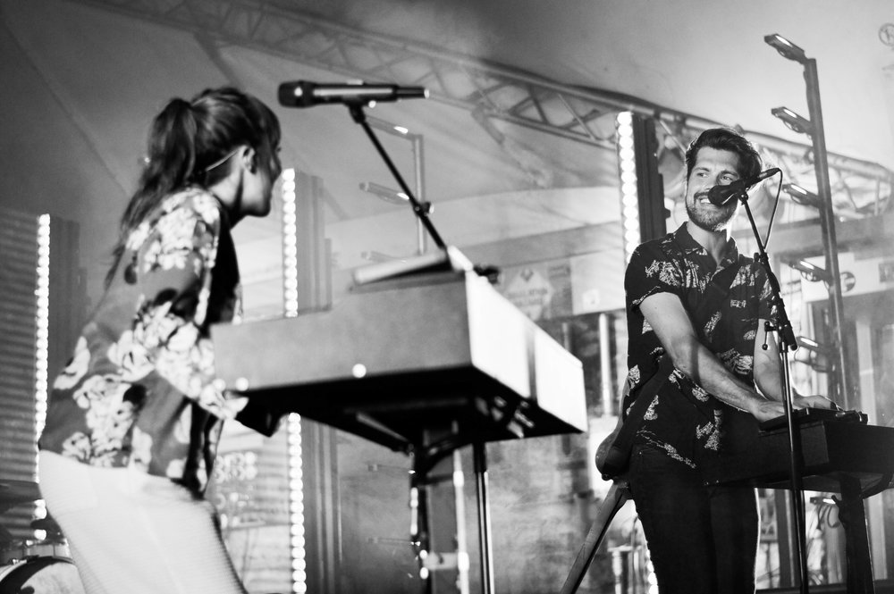 Oh Wonder share infectious smiles on stage.