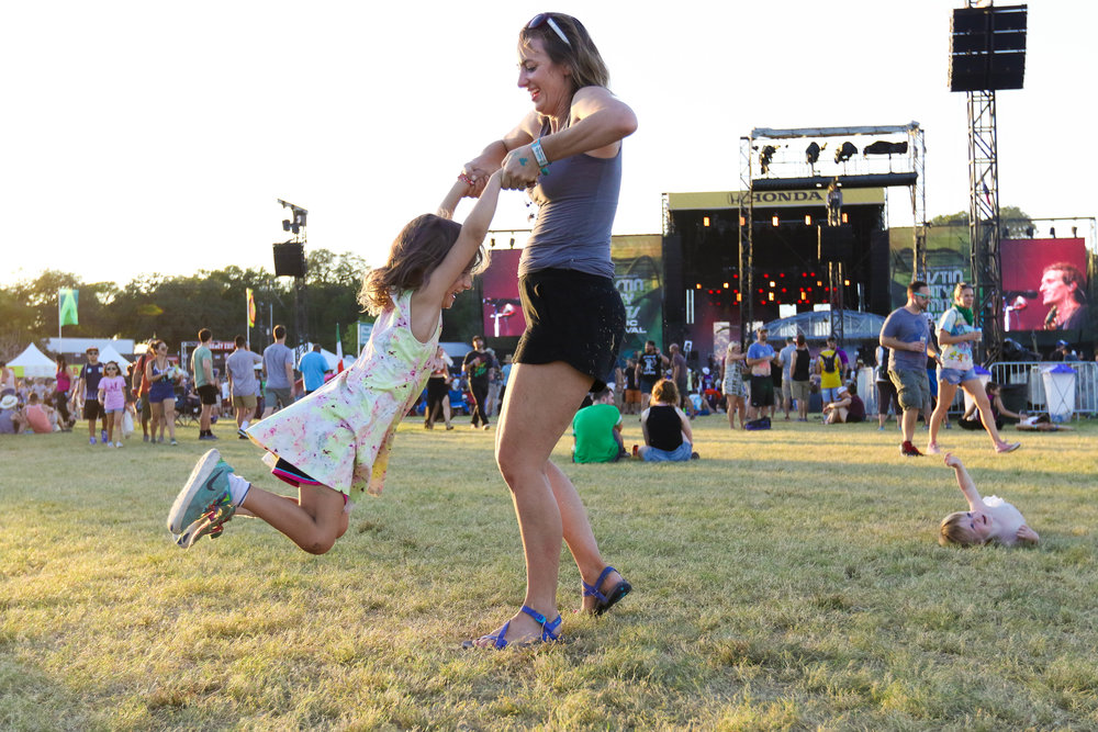 Mother and daughter share in a fun moment together at the fest.