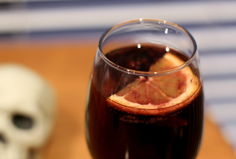 Blackberry sangria is a dark, fruity drink perfect for Halloween parties.