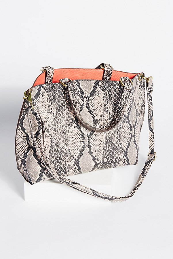Reversible Vegan Crossbody ($42) - This vegan leather staple is versatile enough to upgrade any outfit. A fun pop of color on the inside lining is anything but boring, and the classic snake print on the outside will match anything.