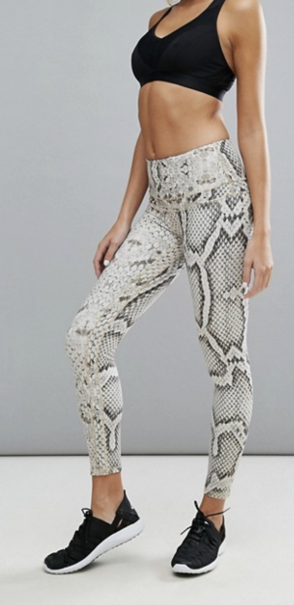 ASOS Varley Snake Print Legging ($119) - The high-rise waist, elastic fit and smartly positioned patterning on these leggings makes them functionally and visually ideal — a win-win. Pair with classic black tennis shoes and add in a pop of color with a bright sports bra.