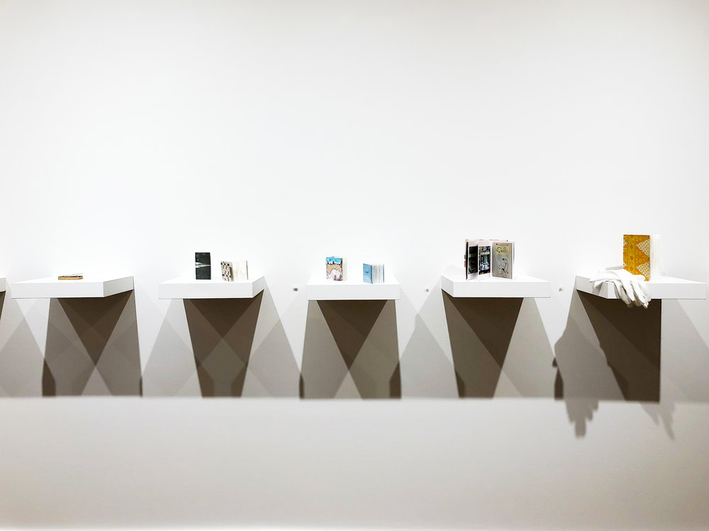 The series of small, handmade books welcome the visitor into the exhibit with words, sketches and photographs that question the meaning of truth.