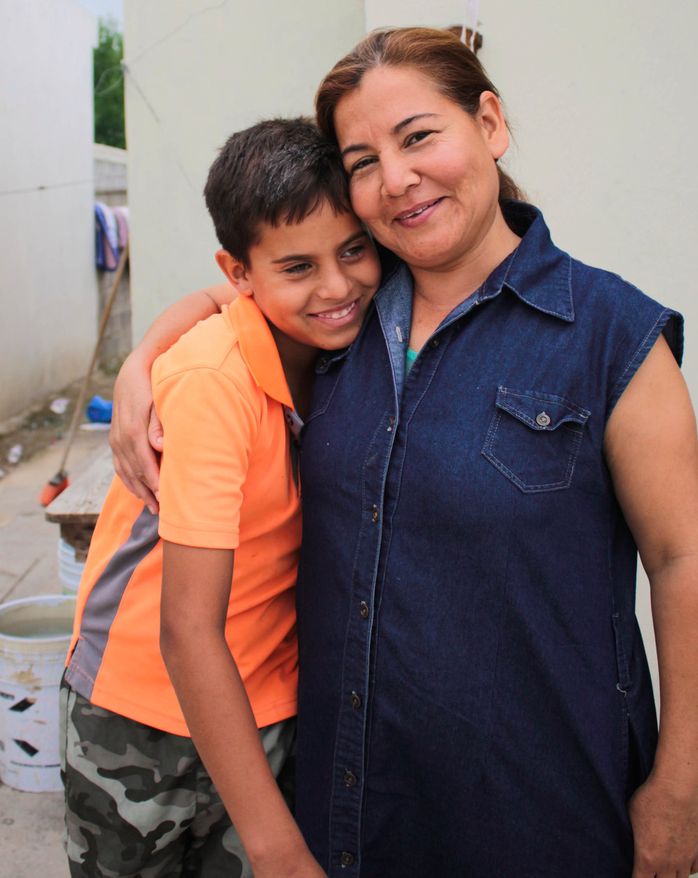Norma Villa, single mother of two, is one of many maquiladora workers who have to leave their children unattended for long periods of time.