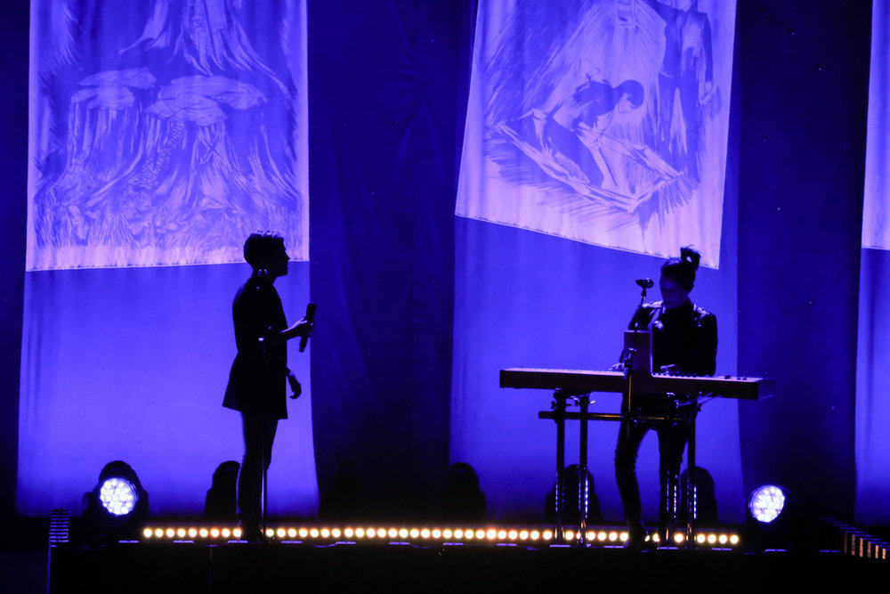 The colorful backlit stage created silhouettes of the artists during slower numbers.