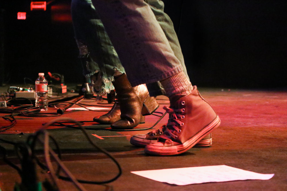 Overcoats show off their coordinated dance moves in their differing shoe styles.