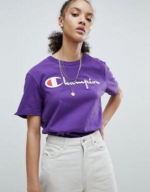Champion Crewneck T-shirt - $50 - Trade in your simple white t-shirt with an ultraviolet one from Champion. Highlight the white lettering with your favorite pair of white bottoms. Find it here.