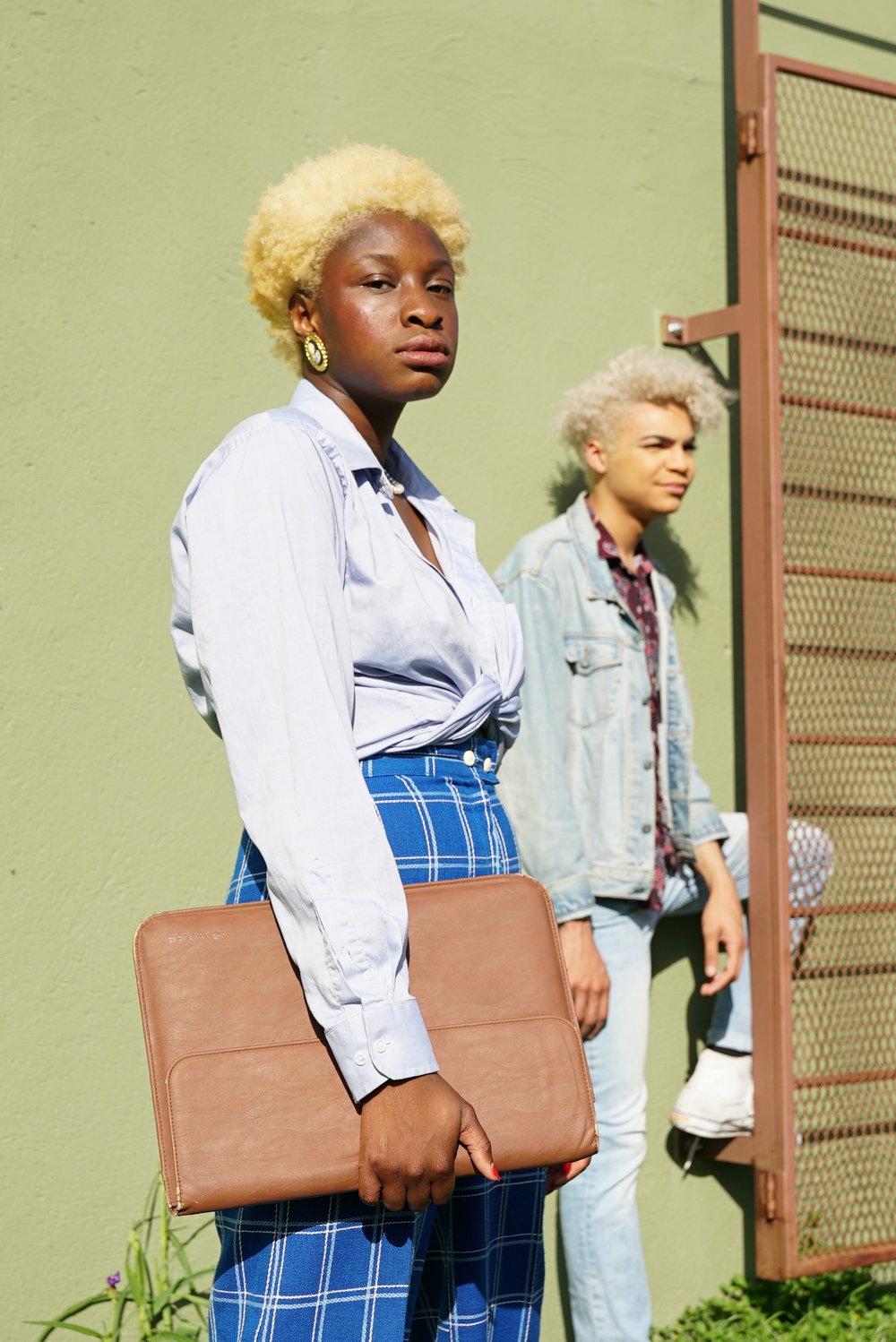 Amudo wears blue and Lewis wears denim on denim to show their personal styles choices.