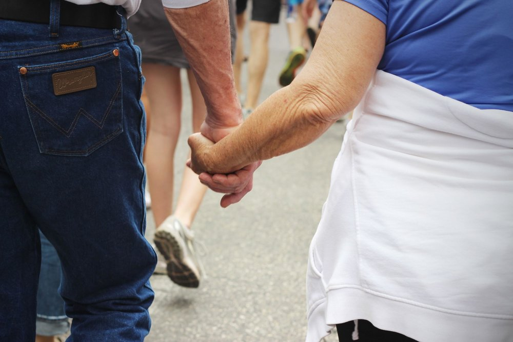 Loved ones lock hands as they march.