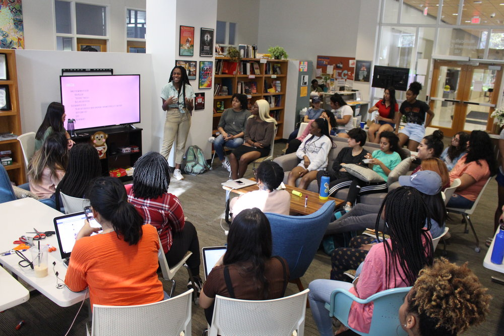 Students listen to a presentation about relationship health, located in UT's Multicultural Engagement Center.