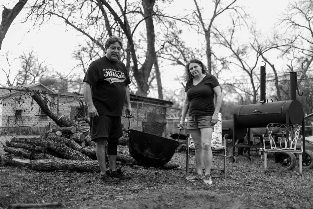Jesse and his wife Diana Cortez hold a pot, that is used to make tamales outside in a small pit in the ground. They have been carrying on this tradition for years.