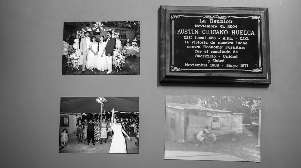 "On the wall hangs photos of the original house, Jesse's wedding with Diana and a plaque given to Frank ""Poncho"" Ramirez, Jesse's Uncle, by Sen. Gonzalo Barrientos for participating in the Economy Furniture Company Strike. The protest demanded for higher wages for Mexican workers."