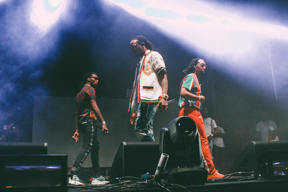 Migos walks around stage as their set begins.
