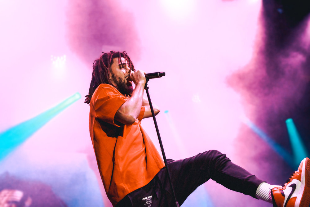 J. Cole rapped and danced across the stage throughout his set.