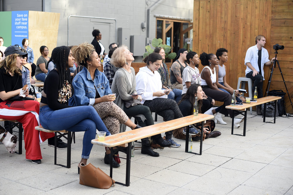 The audience attentively listens to the panel at the intimate Space 24 Twenty location.