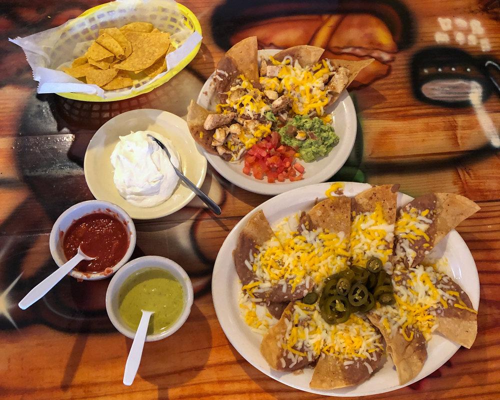 Two nacho appetizers with chips, salsa and guacamole from El Secreto de La Abuela