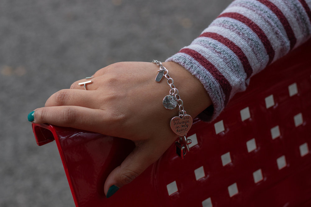 Samantha Chavez wears a bracelet adorned with personal silver charms.