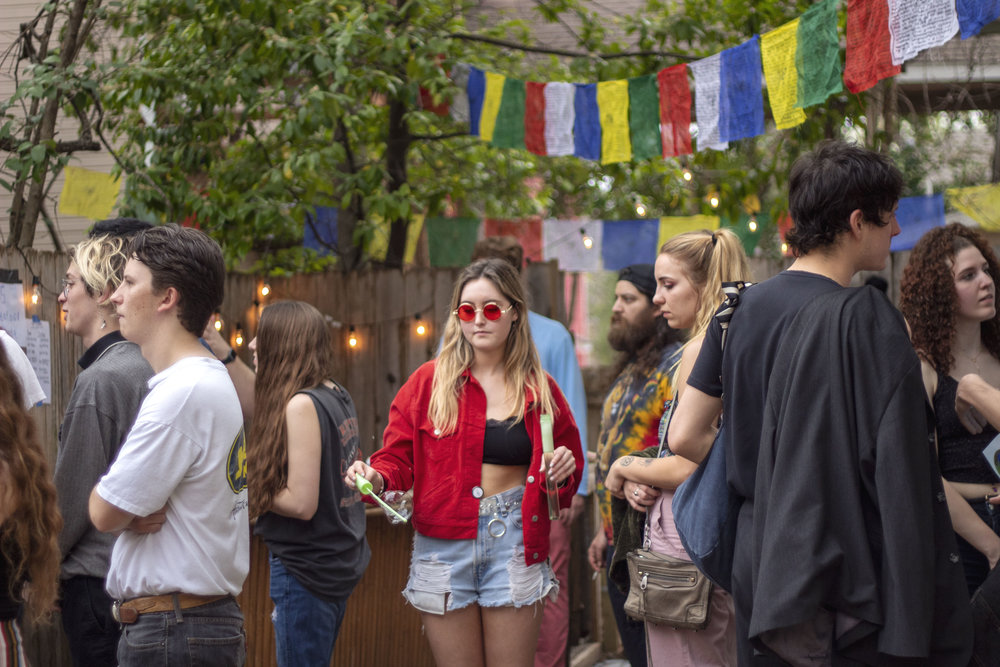 Lauren Gold, Arizona State University student, spends her spring break at PorchFire Fest blowing bubbles with red shades and a matching jacket.