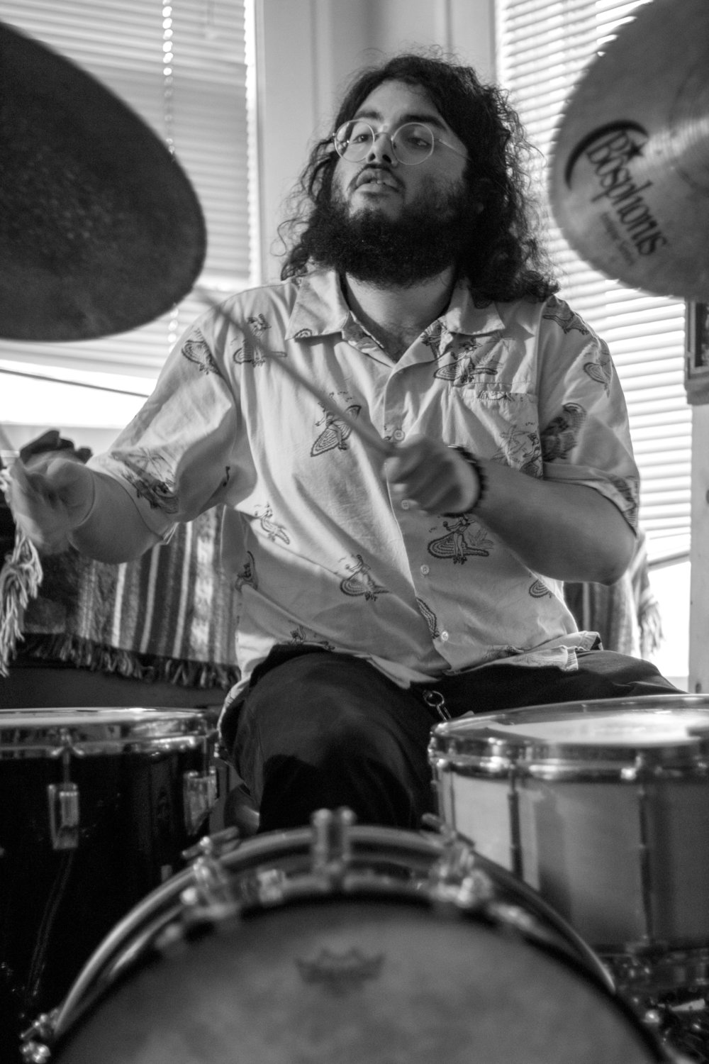 Drummer Brandon Medellin plays with HYAH! on PorchFire's indoor stage.