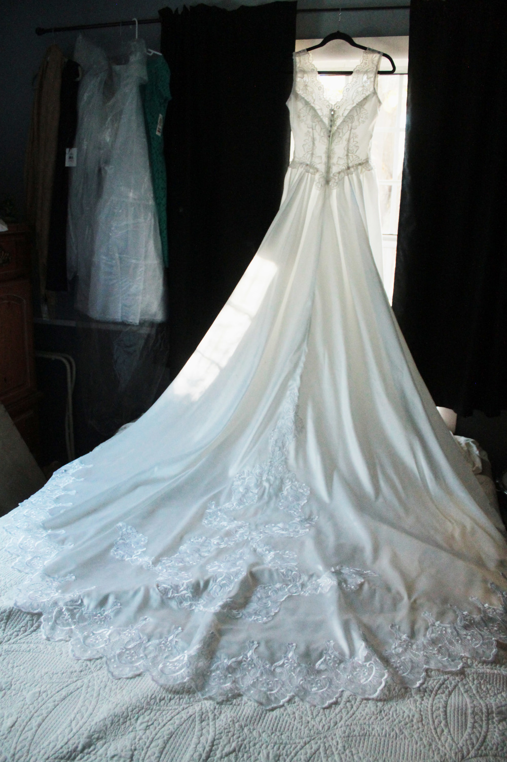 There are so many reasons why this image is awesome. First off, it was from my first wedding. Second off it was the bride's mother's dress altered and modernized and I love a dress with a story! Thirdly, it just looks stunning hanging over the bed!