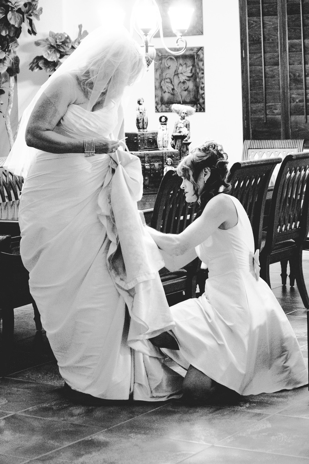This image isn't of the best quality, but it is a sweet moment between sisters. The bride's sister was bustling the dress for the reception and when nobody else was around I caught this moment. I love moments like these....