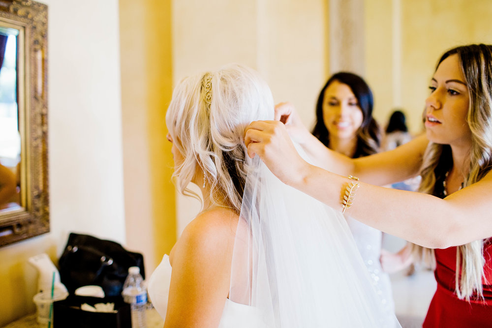 Putting on the Veil- Arizona Wedding Photographer