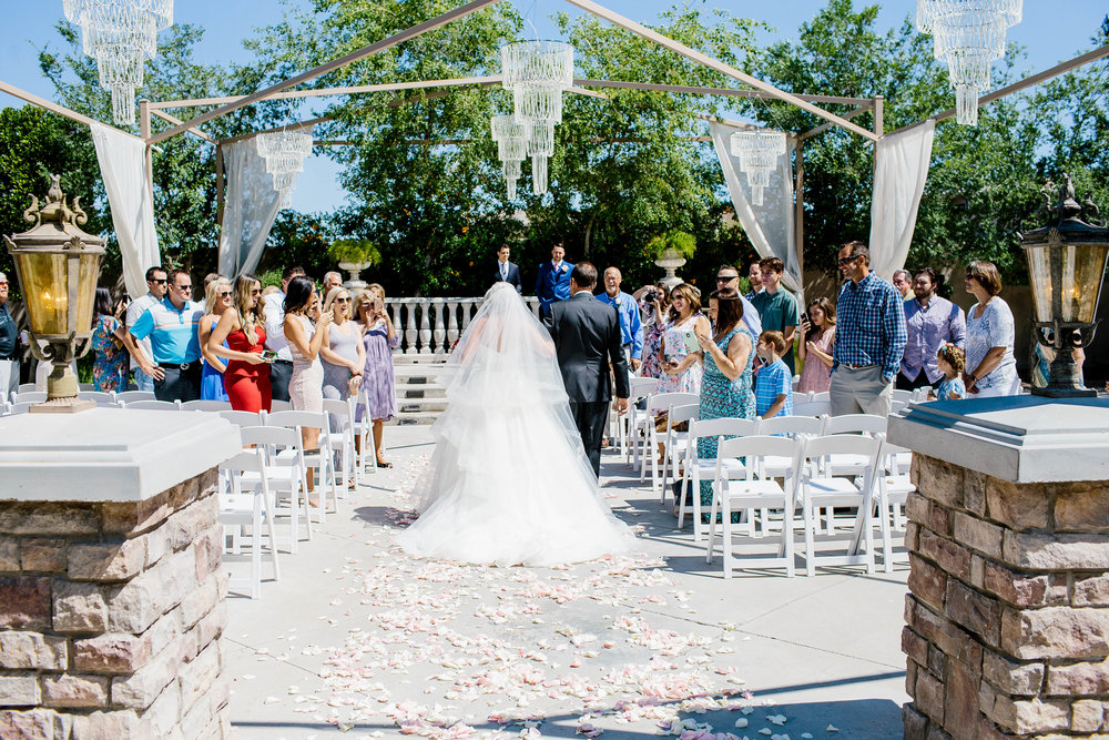 Bride Walking Down the Aisle at the Ashley Castle- Arizona Wedding Photographer