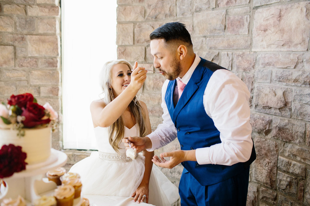 Feeding the Groom the Cake- ARizona WEdding Photographer