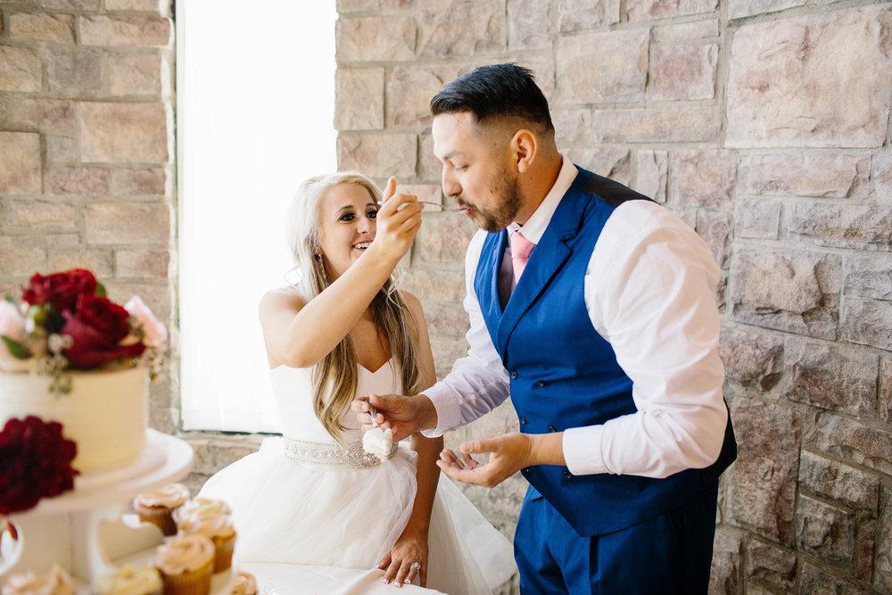 Feeding the Groom the Cake- ARizona WEdding Photographer