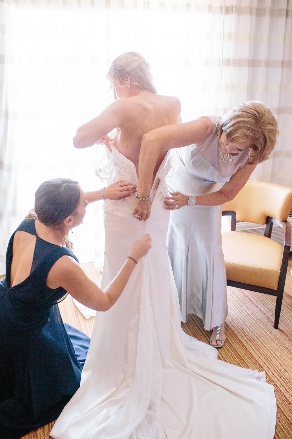 Getting on the Dress- Arizona Wedding Photographer