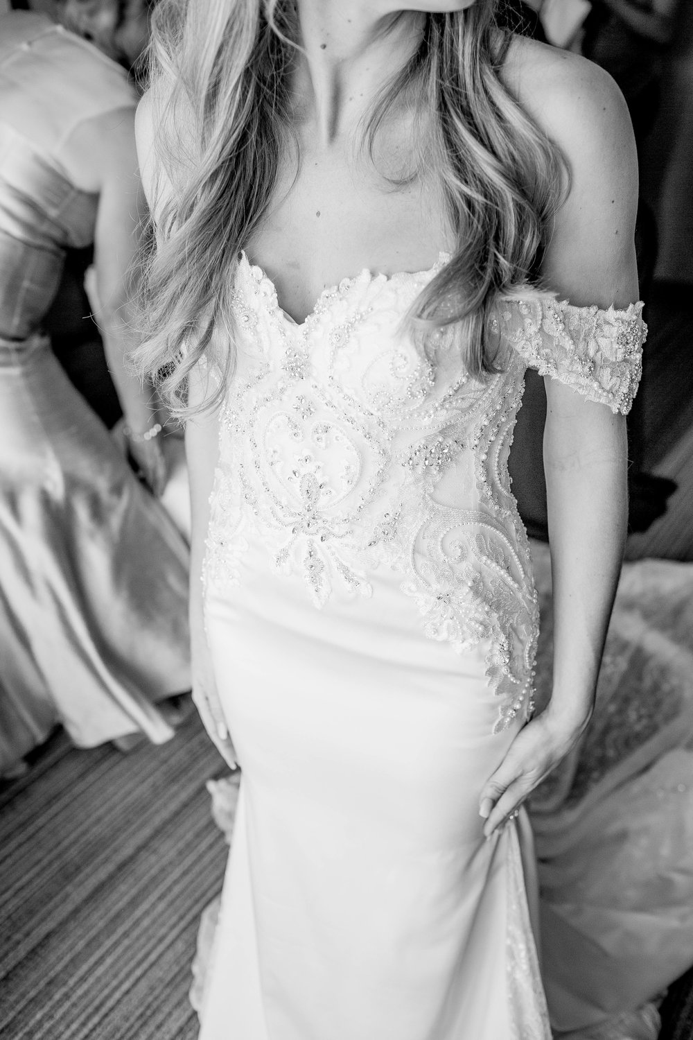 Putting on the dress- Arizona Wedding Photographer