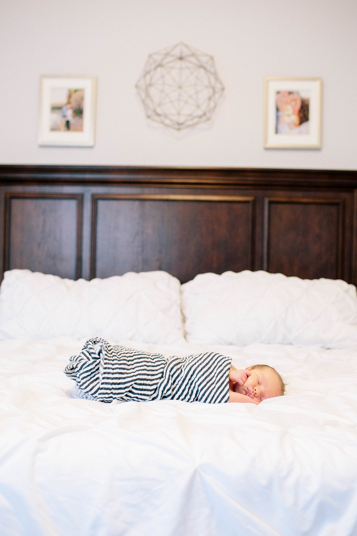 Newborn laying on bed- Arizona Newborn Photography