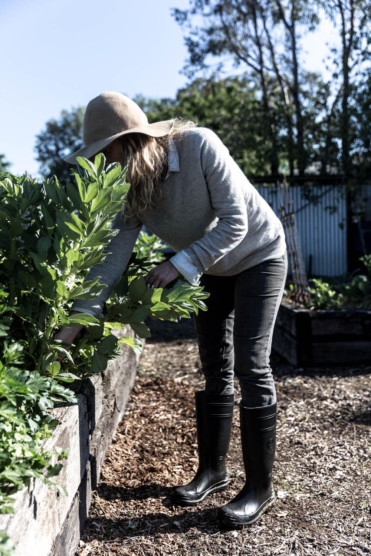 Caitlin raiding Kim's veggie patch