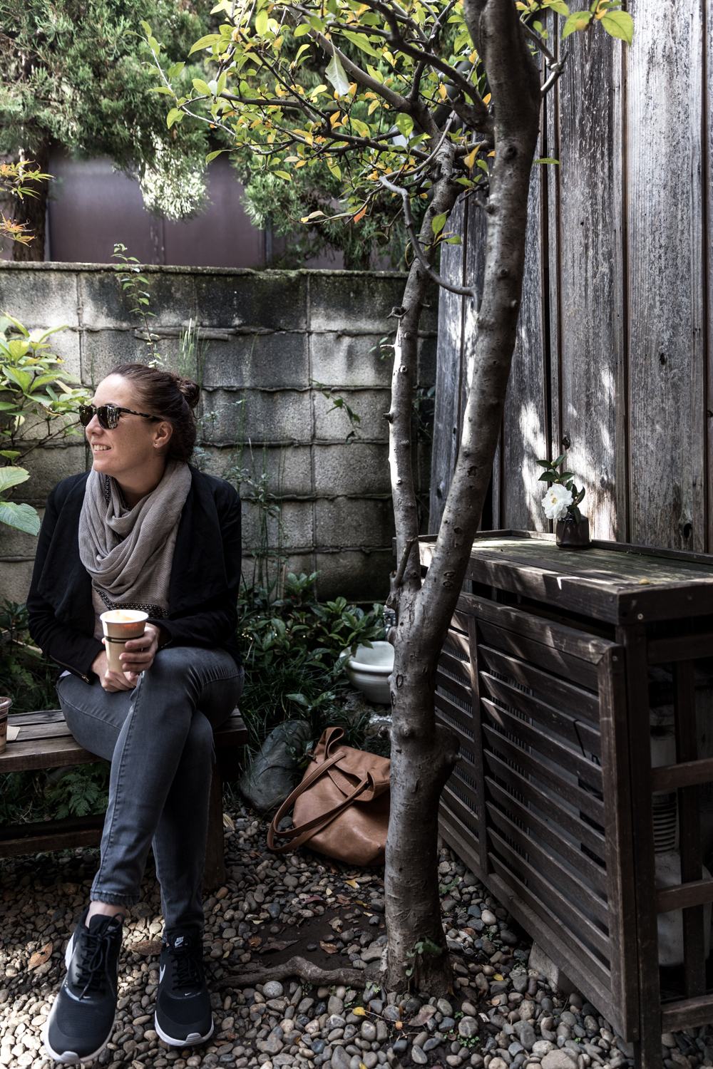 Amy in the courtyard garden at Omotesando Koffee