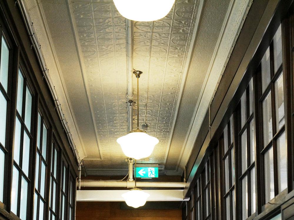 Pressed metal ceilings with original light fittings