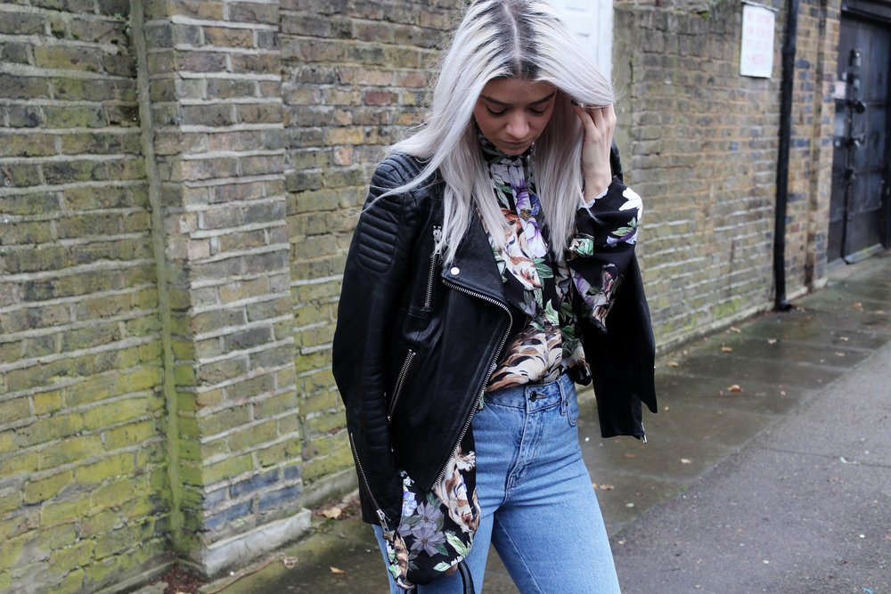 printed ruffle shirt, leather jacket, jeans
