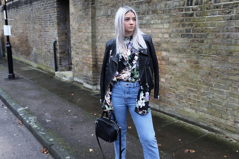ruffle printed shirt, leather jacket, denim jeans