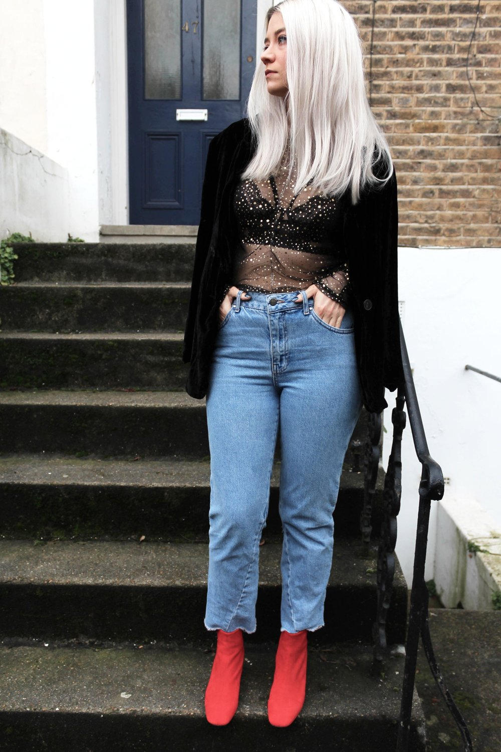 white blonde hair red suede boots, raw edge jeans, meah top, northern magpie