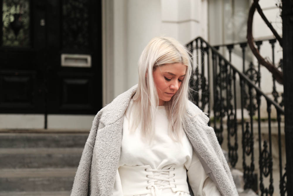 white blonde hair, cream corset belt, cream sweatshirt, northern magpie