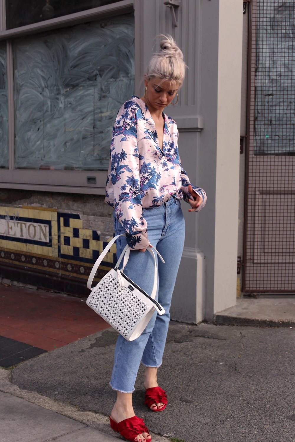 pyjama silk shirt, blue wash denim jeans, red ruffle shoes, white handbag, northern magpie