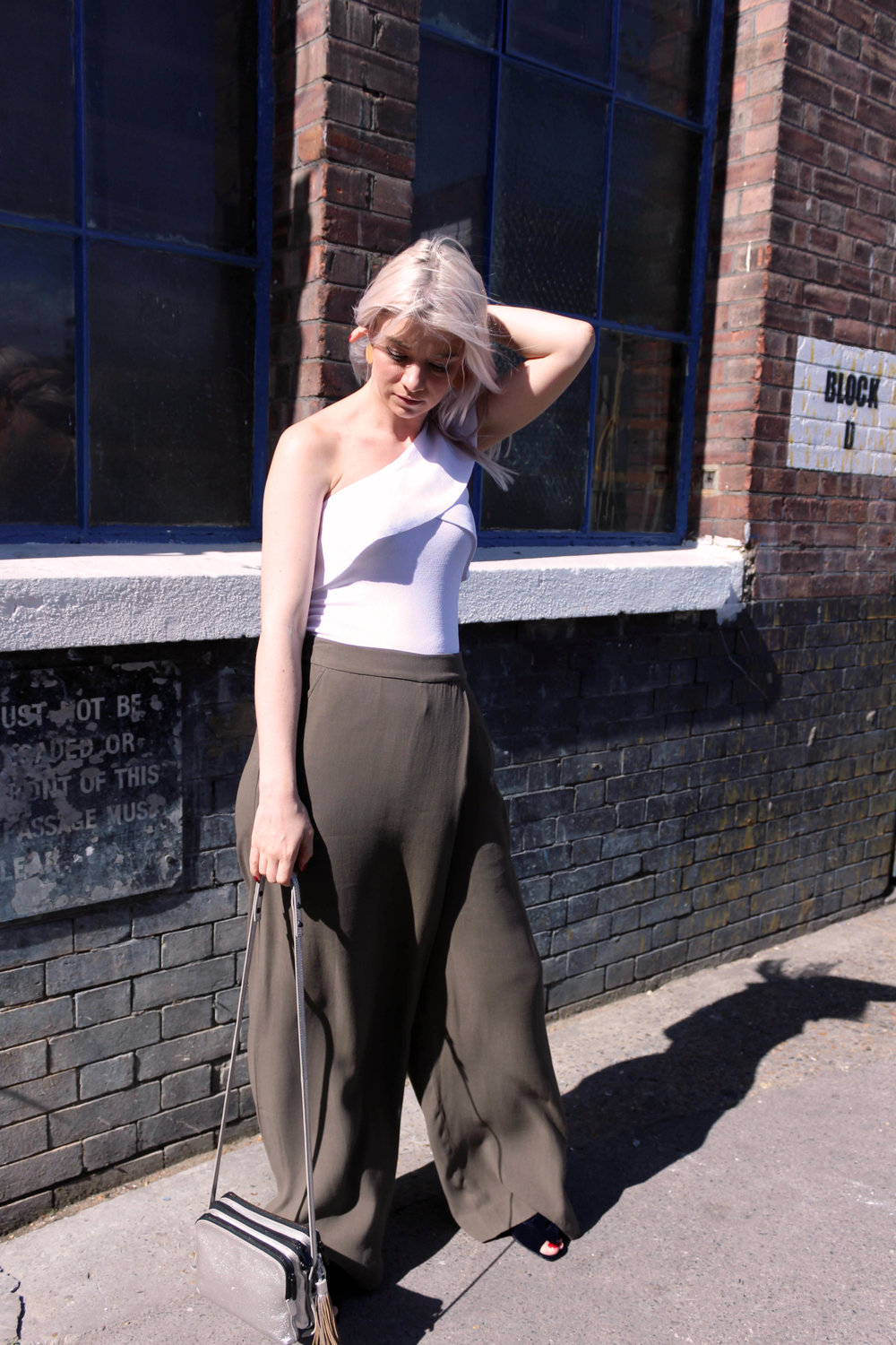 one shoulder top, khaki trousers, wide leg tousers, northern magpie, silver bag