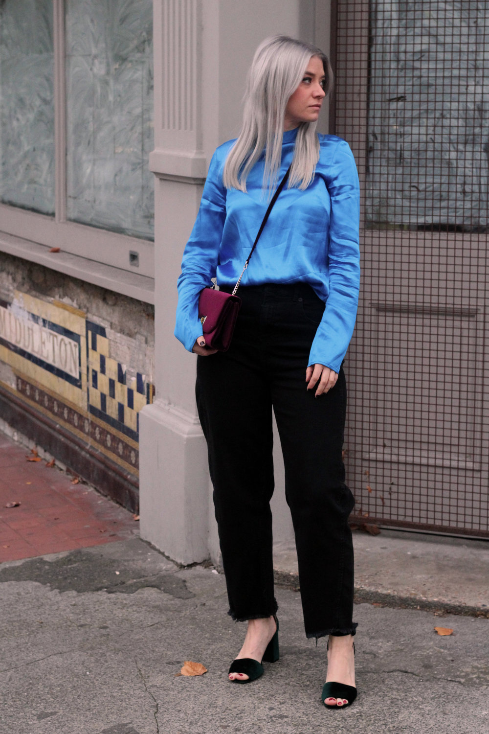 blue satin top, black whitles jeans, velvet heels, velvet handbag 1
