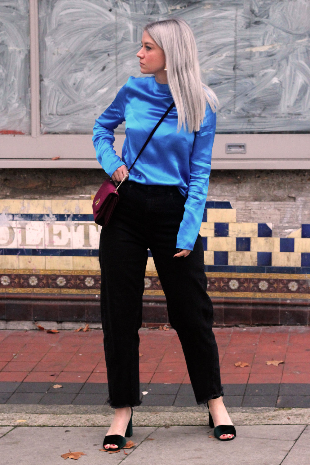 blue satin top, black whitles jeans, velvet heels, velvet handbag, grey hair 3